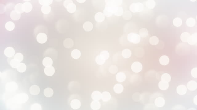 vídeos de stock e filmes b-roll de abstract clean blurred soft glitter dust tiny moving rising glitter bokeh particles soft loopable background - fundo cinza