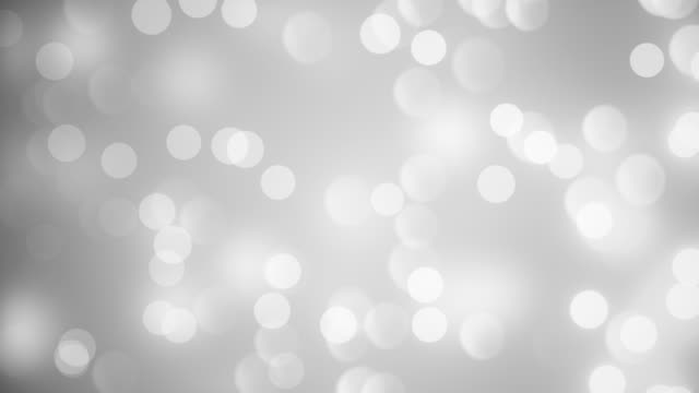 abstract clean blurred soft glitter dust tiny moving rising glitter bokeh particles soft loopable background - silver coloured stock videos & royalty-free footage