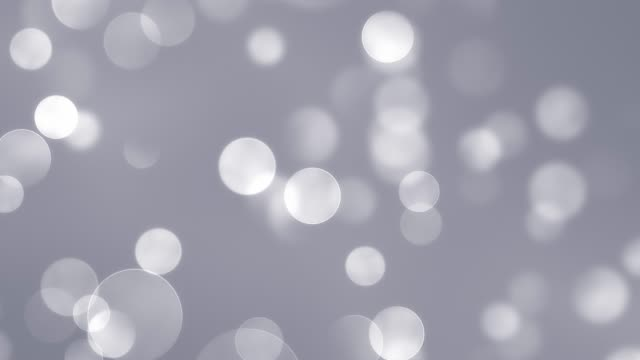 abstract clean white blurred soft glitter dust tiny moving rising glitter bokeh particles soft loopable background - grey colour stock videos & royalty-free footage