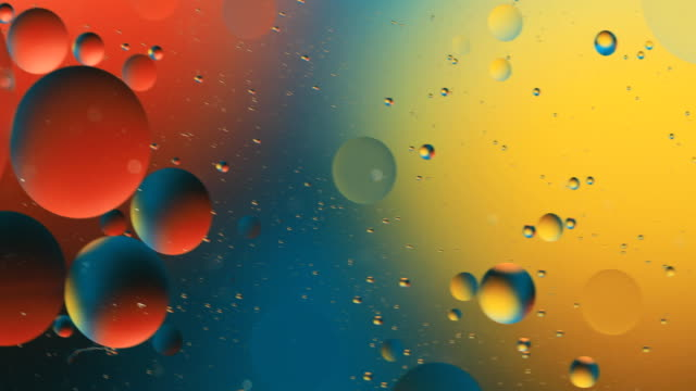 vidéos et rushes de abstract colorful background. drops of oil in water. rainbow colors - variété