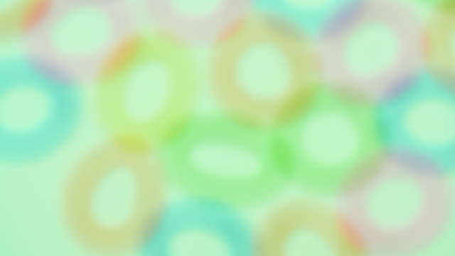 abstract defocussed circles rotate - green background stock videos & royalty-free footage
