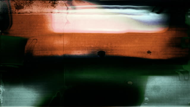 Abstract film leader forms flicker and blur (Loop).