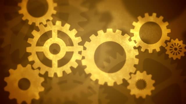 vídeos de stock, filmes e b-roll de gears circulares abstrato ouro vintage - dente de engrenagem