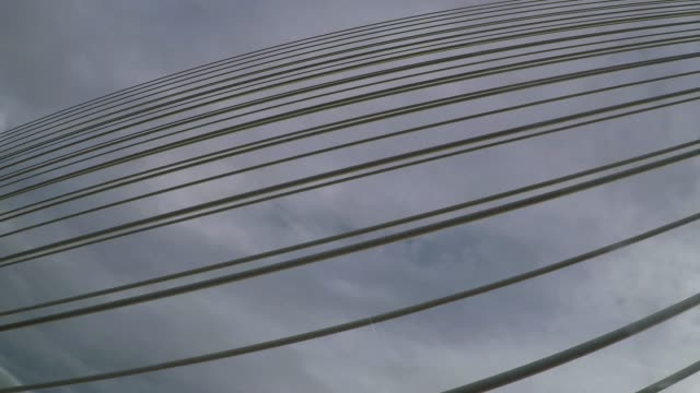Abstract geometric pattern of steel cables from cable-stayed bridge