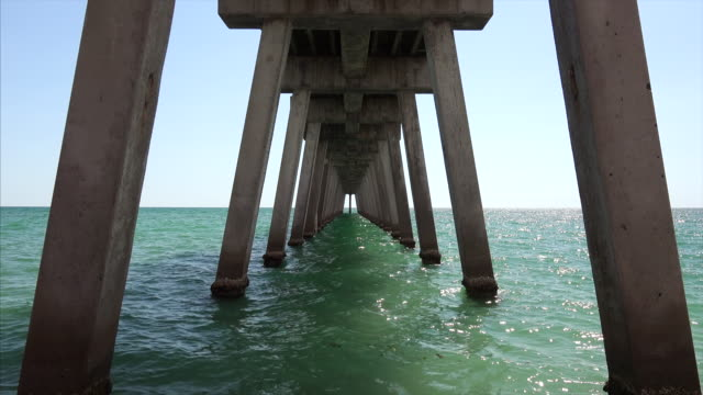 Abstract geometric shapes and diminishing perspective underneath fishing pier in Venice, Florida
