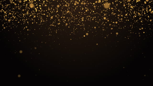abstract gold particle glowing over dark background - decoration stock videos & royalty-free footage
