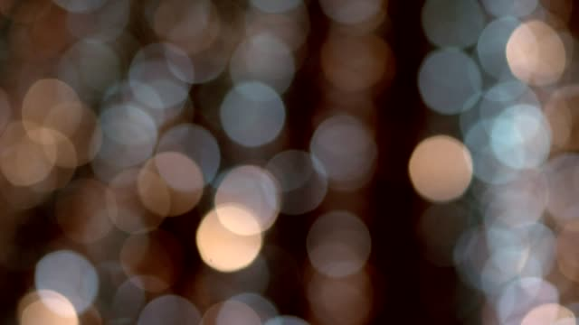 abstract golden bokeh background with shining defocus sparkles - soft focus stock videos & royalty-free footage