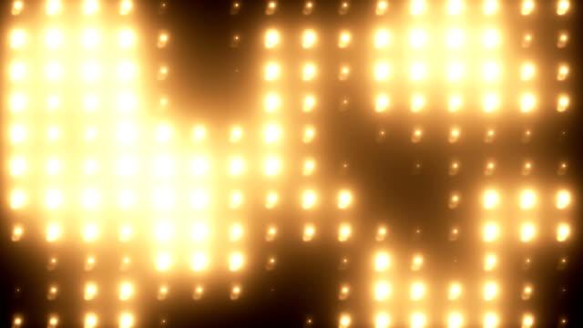 vídeos de stock e filmes b-roll de abstract golden floodlight light wall loopable background - iluminado por holofote