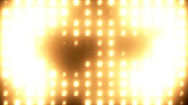 abstrakte goldene flutlichtwand loopbaren hintergrund - led leuchtmittel stock-videos und b-roll-filmmaterial