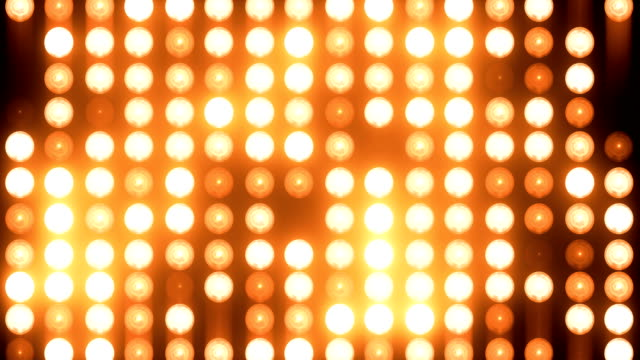abstract golden floodlight light wall loopable background - searchlight stock videos & royalty-free footage