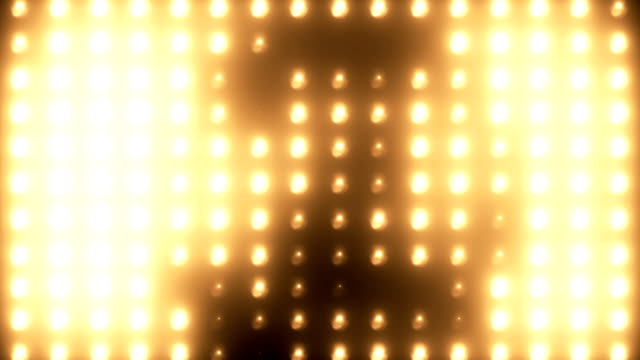 abstract golden floodlight light wall with growing circle shape loopable background - searchlight stock videos & royalty-free footage