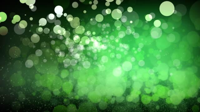 vídeos de stock, filmes e b-roll de fundo de textura bokeh abstrato verde - purpurina
