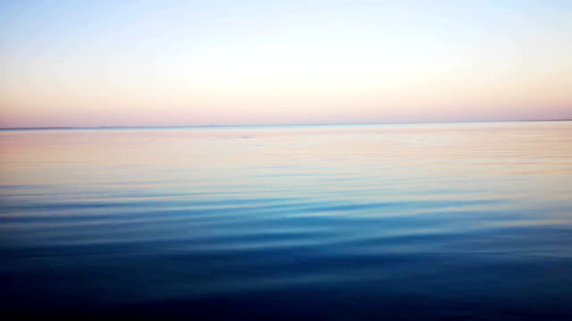 abstract lake or sea surface at sunset - light natural phenomenon stock videos & royalty-free footage