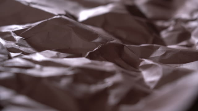 vídeos de stock e filmes b-roll de abstract landscape of brown wrinkled paper - castanho