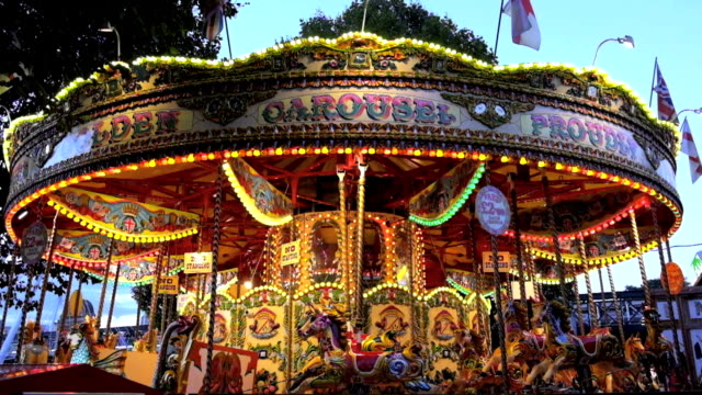 abstract light carousel, circus and amusement park with kids, london - roundabout stock videos and b-roll footage