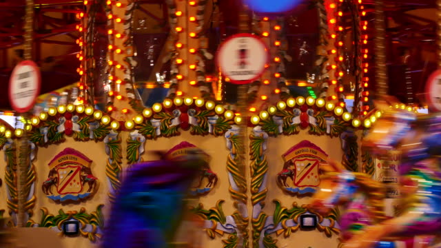 4k abstract light carousel, circus and amusement park with kids, london - roundabout stock videos and b-roll footage