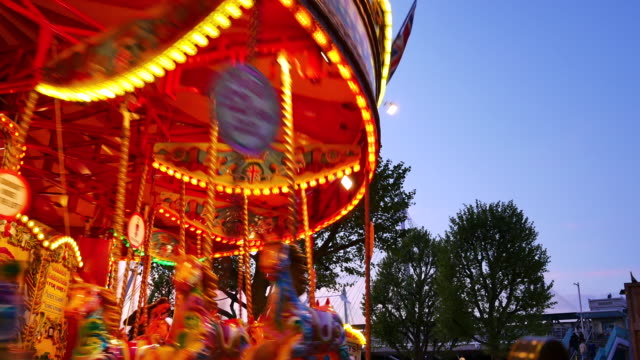 4k abstract light carousel, circus and amusement park with kids, london - fairground stock videos and b-roll footage