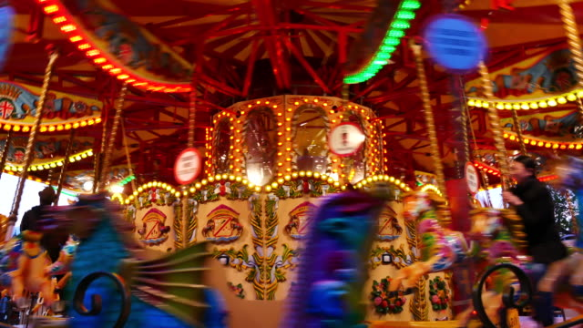 4k abstract light carousel, circus and amusement park with kids, london - roundabout stock videos & royalty-free footage