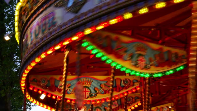 4K Abstract light Carousel, circus and Amusement park with kids, London