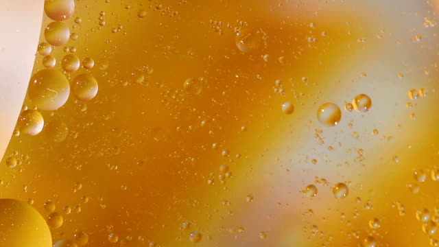 abstract liquid background - cooking oil stock videos & royalty-free footage