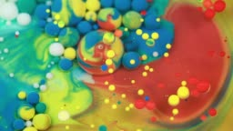 Abstract multicolored bubbles paint. Slow motion. Top view