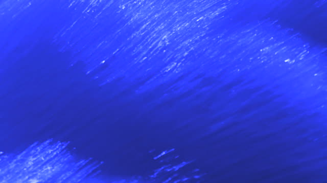 hd abstract of flowing blue water (loopable) - geschwindigkeit stock videos & royalty-free footage