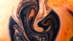 Abstract psychedelic background. Ink is poured into a multicolored liquid with a slow motion