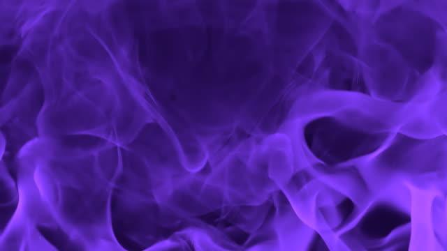 hd slow-motion: abstract purple flames - tonad bild bildbanksvideor och videomaterial från bakom kulisserna