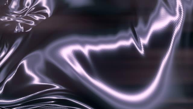 vidéos et rushes de tissu métallique brillant abstrait. arrière-plan d'animation au ralenti. rendu 3d. résolution 4k, ultra hd - lévitation