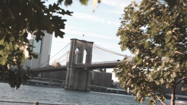 abstract shot of new york city's brooklyn bridge at sunset. - east river stock videos & royalty-free footage