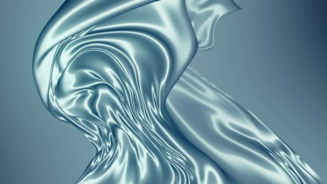 abstrakt silver glänsande metallisk trasa. slow motion animation bakgrund. 3d-rendering. 4k uhd - silverfärgad bildbanksvideor och videomaterial från bakom kulisserna