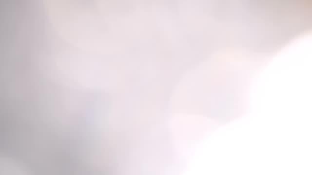 抽象的な輝く粒子の小さい大ぼけを移動 - ラメグリッター点の映像素材/bロール