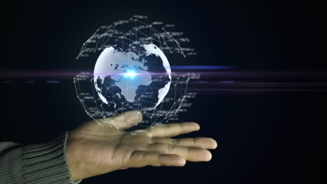 abstract spinning globe with futuristic communication around on hand, global communication in hand - hologram stock videos & royalty-free footage