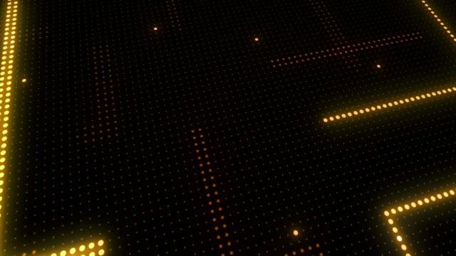 vídeos y material grabado en eventos de stock de fondo de tecnología abstracta de partículas de pantalla led. animación de luz de circuito. (loopable) - fondo naranja