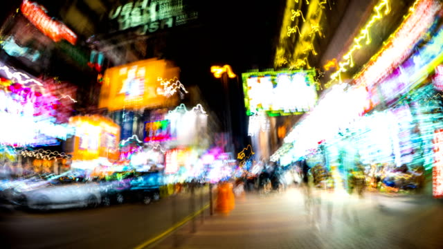 abstract time lapse hyperlapse walking in the shopping area at night in mong kok, hong kong - mong kok stock videos & royalty-free footage