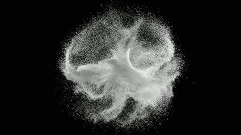 abstract white powder splatter on black background - spray stock videos & royalty-free footage