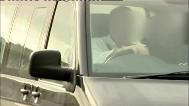 abu qatada arrives home after winning deportation appeal england worcestershire south littleton ext abu qatada in car with face of qatada and driver... - アブ クアタダ点の映像素材/bロール