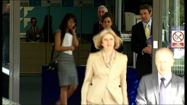 judge may free qatada again ext may departing conference centre and getting into car - アブ クアタダ点の映像素材/bロール