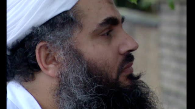 details of bail conditions tx motion close shots of abu qatada's face and hands - アブ クアタダ点の映像素材/bロール
