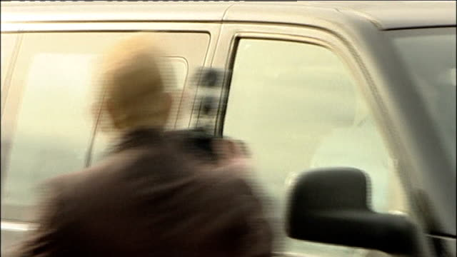 abu qatada to be deported; lib / tx worcestershire: south littleton: **beware flash photography ** vehicle driven towards past press freeze frame - フリーズフレーム点の映像素材/bロール