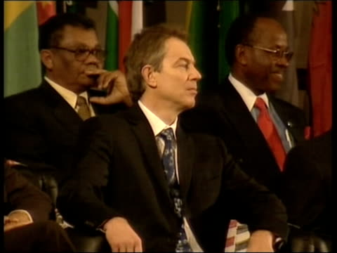 abuja prime minister tony blair mp sitting in meeting of commonwealth leaders blair shrugging as chatting to commonwealth leader - shrugging stock videos and b-roll footage