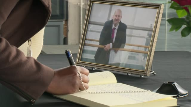 Carl Sargeant suicide Carwyn Jones defends actions Various shots of woman writing in book of condolence for Carl Sargeant Welsh Government...