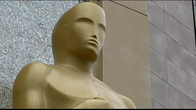 Preview USA California Hollywood People to and fro in street Low Angle shot of Oscar statue Low Angle shot of plastic cover over red carpet Shots of...