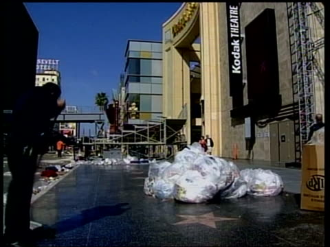 california los angeles hollywood boulevard street covered in debris from oscars crowds side lms man along as sweeping up rubbish on morning after... - russell crowe stock videos & royalty-free footage
