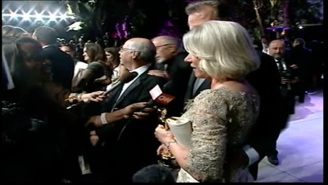 helen mirrren wins best actress award; usa: los angeles: kodak theatre: side view mirren on red carpet dissolve to - helen mirren stock videos & royalty-free footage