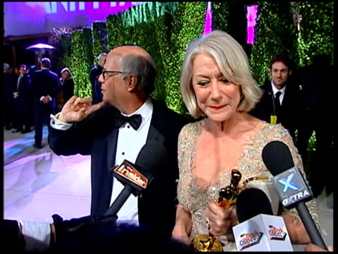 """vanity fair oscars party; helen mirren, winner of best actress award for her role in """"the queen"""", interview sot - talks of winning and about paying... - helen mirren stock videos & royalty-free footage"""