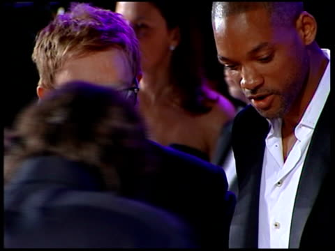 vanity fair oscars party sir elton john talking to will smith and along with his partner david furnish - vanity fair video stock e b–roll