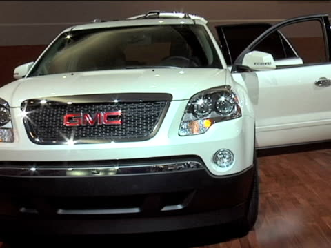 acadia suv revolving on turntablefootage is 43 anamorphic it will play back at 853x480 2009 gmc acadia at cobo hall on january 23 2009 in detroit... - curious cumulus productions stock videos and b-roll footage