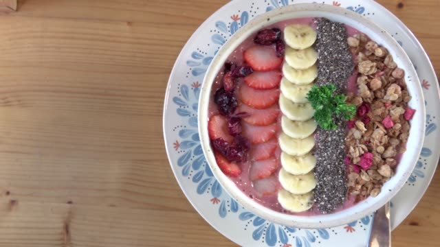 acai berry bowl with fruits and cup of coffee - bowl stock videos & royalty-free footage