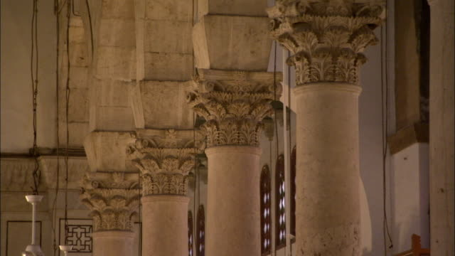 Acanthus leaved capitals top the columns in the interior of the Umayyad Mosque. Available in HD.